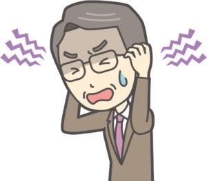 頭痛で悩むおじさん